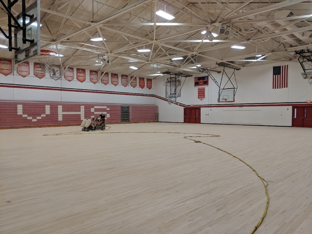 Gym floor being sanded.