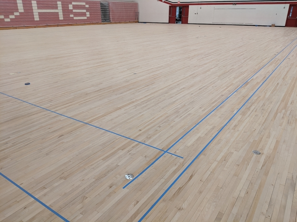 Sanded HS gym floor taped off.