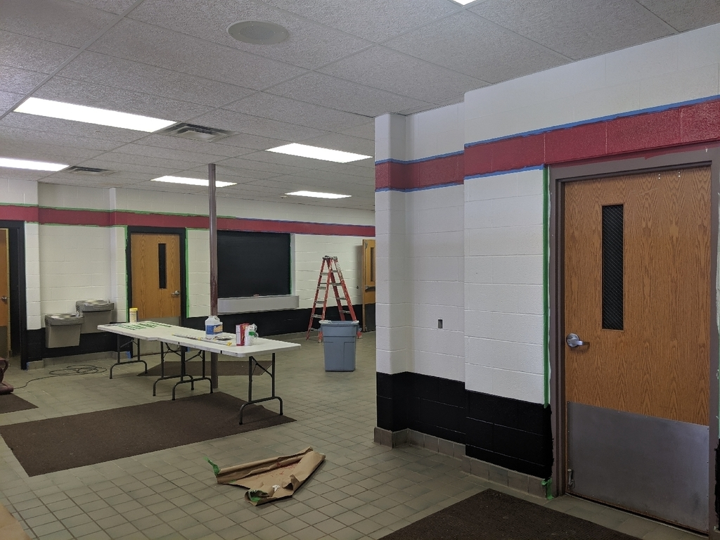Middle school gym lobby being painted.