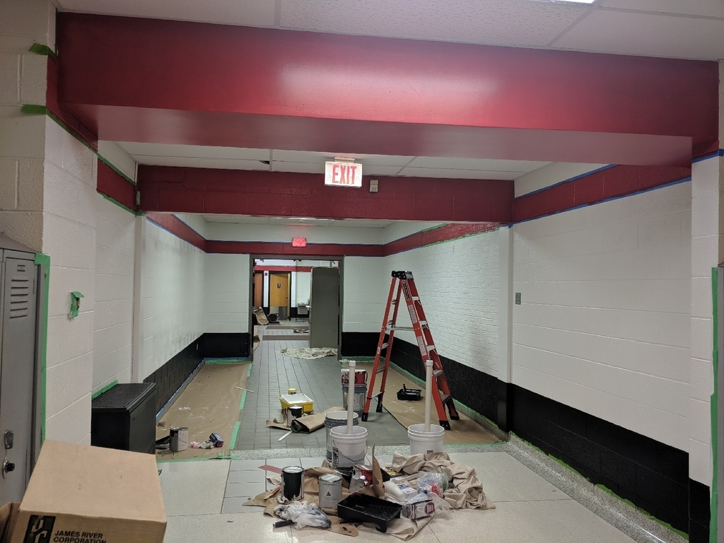 Middle School gym entrance being painted.