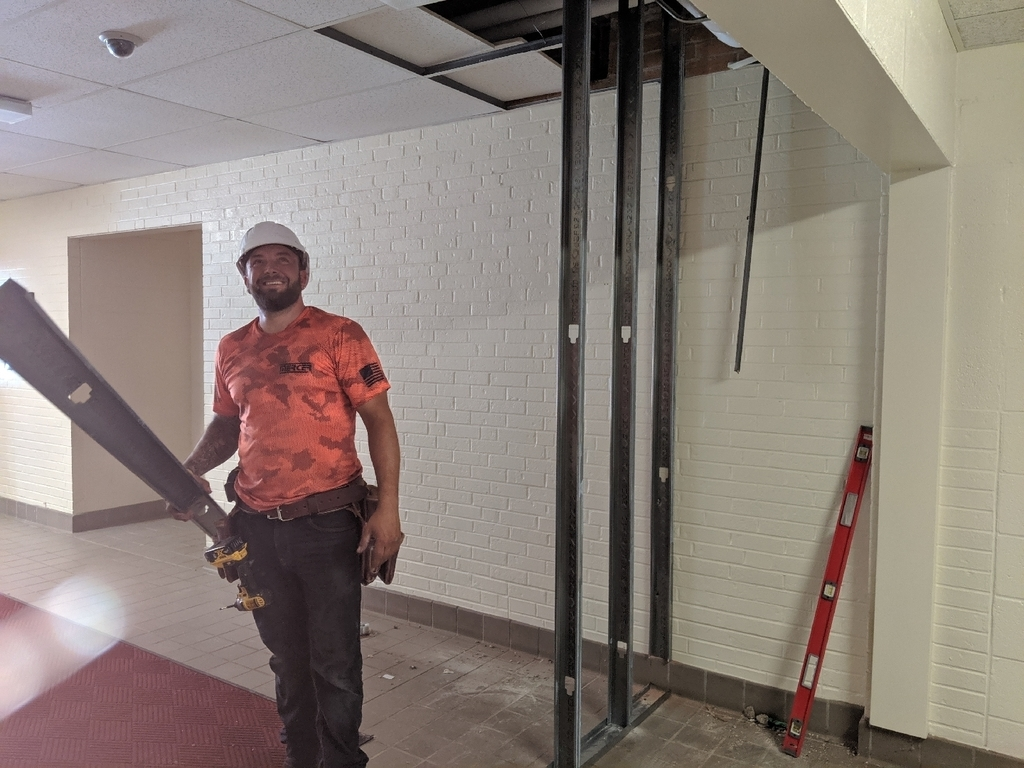 construction worker building Townsend's new vestibule.
