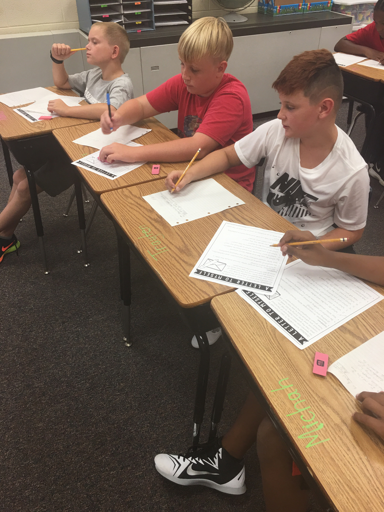 5th graders writing letters