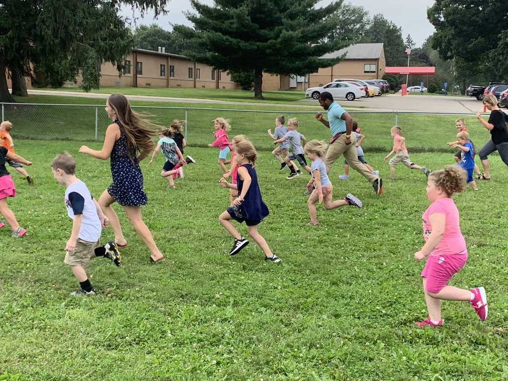 Our new All American Heptathlete Kindergarten Teacher Mr. Smith enjoying recess with his students!!!
