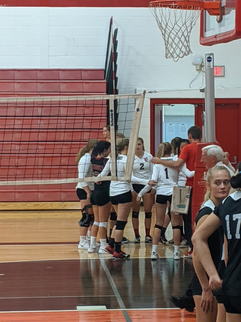 volleyball in huddle