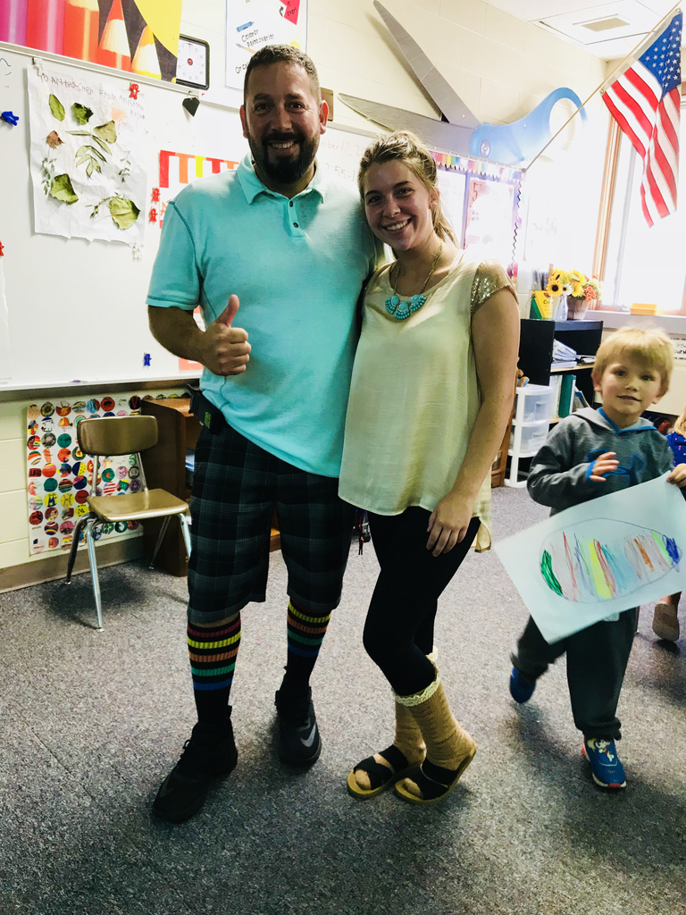 Mr. Tello and Miss H showing off their cool socks!